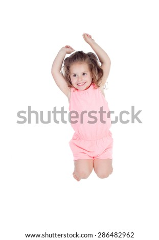 Happy little girl jumping isolated on a white background - stock photo