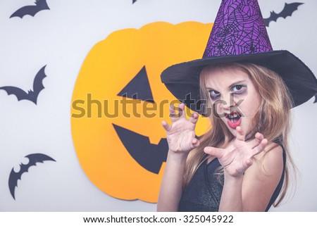 Happy little girl on Halloween party - stock photo