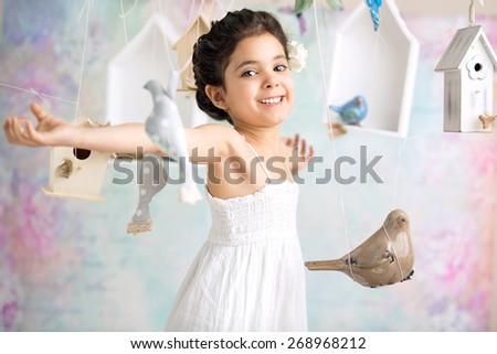 Happy little girl on romantic background - stock photo