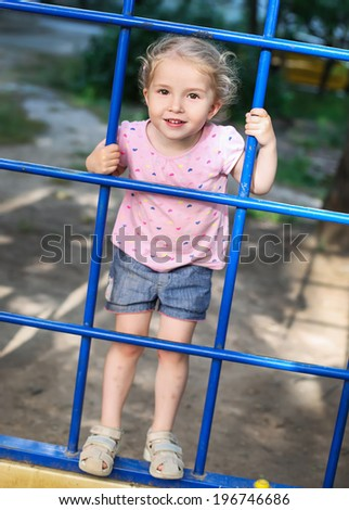 happy little girl on the playground - stock photo