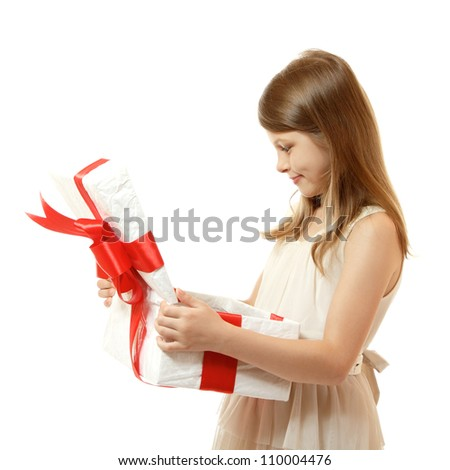happy little girl open box with christmas present, isolated on white background - stock photo
