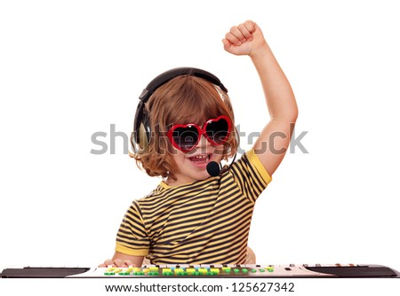 happy little girl play music on keyboard - stock photo