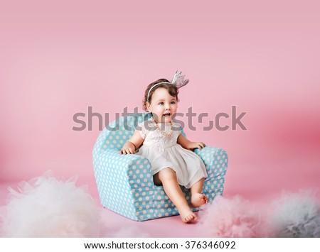 Happy little girl playing - stock photo