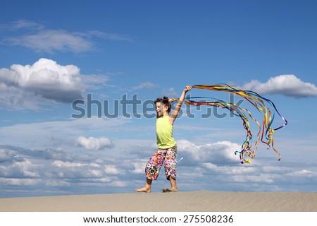 happy little girl playing on beach summer scene - stock photo