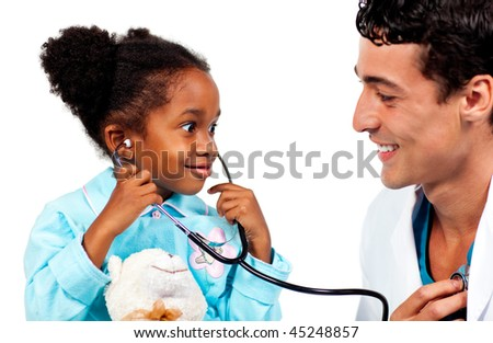 Happy little girl playing with the stethoscope and listening the heart of the doctor - stock photo
