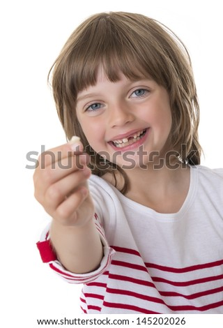 happy little girl pointing her missing teeth in her hand - stock photo