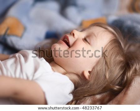 Happy little girl - shallow DOF, focus on front eye - stock photo