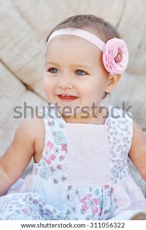 happy little girl sitting on the couch. Close up - stock photo