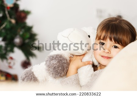 Happy little girl waiting for Christmas - stock photo