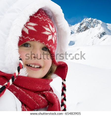 Happy little girl winter vacation - stock photo