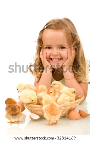 Happy little girl with a basket full of baby chickens - isolated - stock photo
