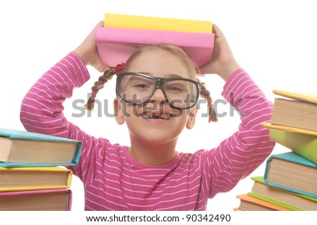 Happy little girl with books wearing black glasses, back to school concept, isolated over white - stock photo