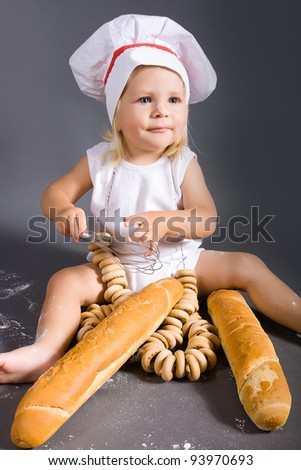 Happy little girl with chef hat - stock photo