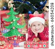Happy little girl with Christmas decoration - stock photo