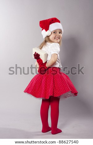 Happy Little Girl with Christmas present - stock photo