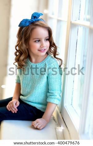beautiful girl wavy hair jeans blue stock photo 400479664