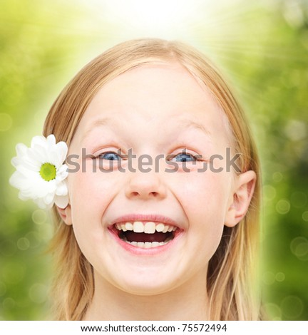 Happy little girl with flower. - stock photo
