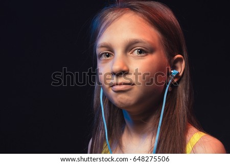 Happy little girl with headphones
