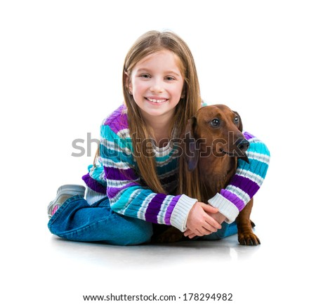 happy little girl with her �¢??�¢??dachshund in the studio on a white background