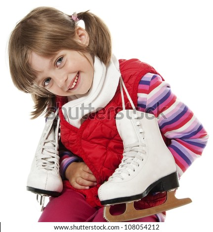 happy little girl with ice skates on white background - stock photo