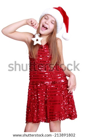 happy little girl with long blond hair in Santa hat holding christmas golden star isolated on white/Christmas portrait of a cute child in a Santa's hat