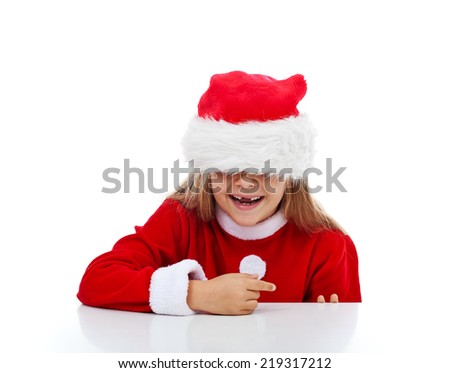 Happy little girl with missing teeth in Santa costume having fun laughing - isolated - stock photo