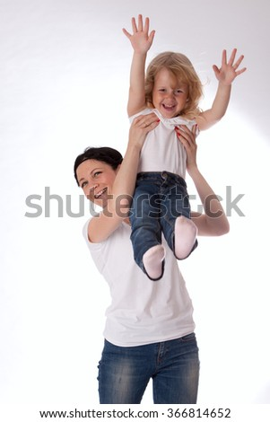 happy little girl with mother