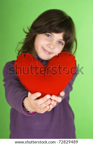 Happy little girl with red valentines heart - stock photo