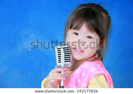Happy little girl with retro microphone - stock photo
