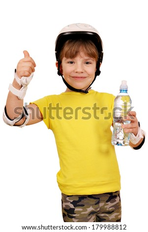 happy little girl with roller skates equipment and thumb up - stock photo