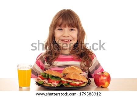 happy little girl with sandwiches apple and juice