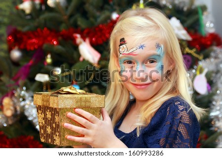Happy little girl with the Christmas gift box - stock photo