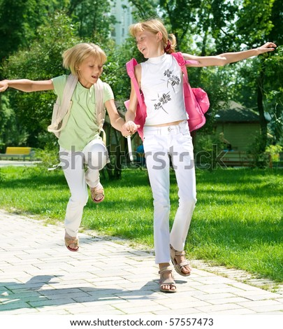 Happy Little Girls Going to School.Education concept - stock photo