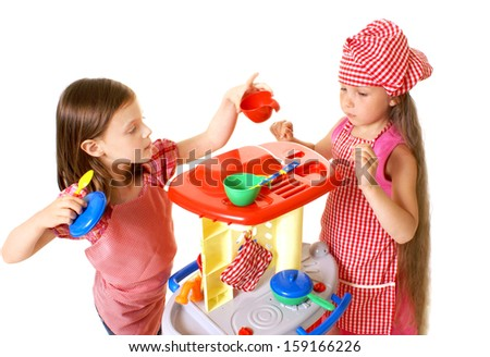 happy little girls play cooking - stock photo