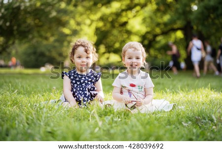 Happy little kids in park - stock photo