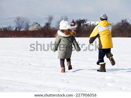 happy little kids running in field - stock photo