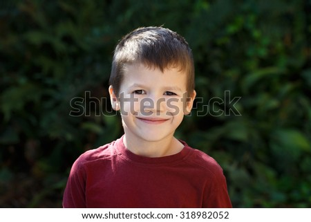 Happy little preschooler boy smile outdoor - stock photo