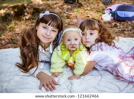 Happy little sisters in park - stock photo
