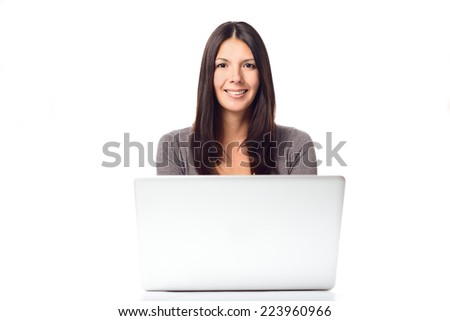 Happy Long Hair Young Woman Busy with her Laptop while Looking at the Camera, Isolated on White Background.