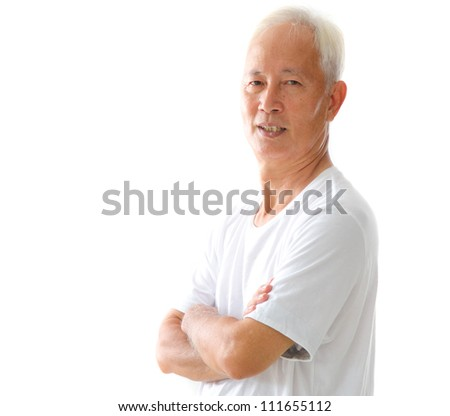 happy looking asian senior male, arms crossed - stock photo