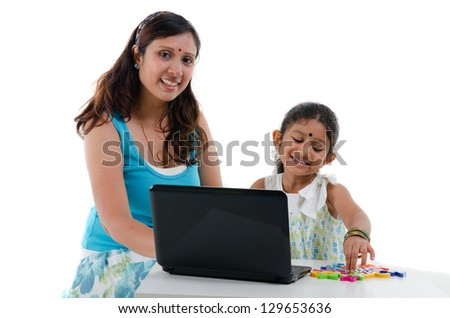 happy looking indian mother and daughter - stock photo
