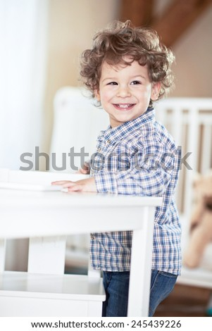 Happy, lovely baby boy in checked shirt smiling. Little scientist - stock photo