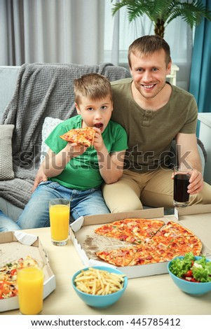 Happy lovely family eating pizza - stock photo