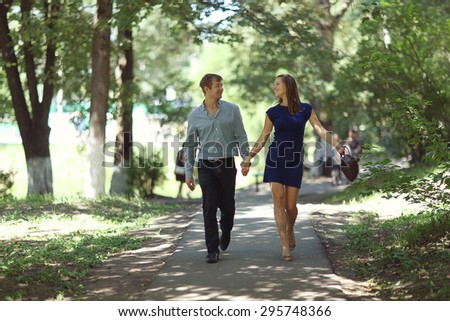 Happy loving couple in a city park young
