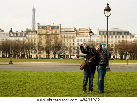 Happy loving couple in Paris having fun ourdoors - stock photo