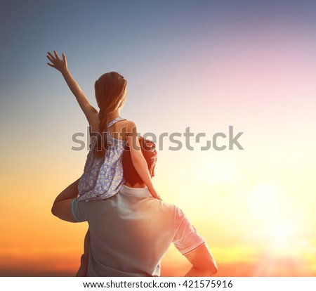 Happy loving family. Father and his daughter child girl playing and hugging outdoors. Cute little girl and daddy. Concept of Father's day. - stock photo