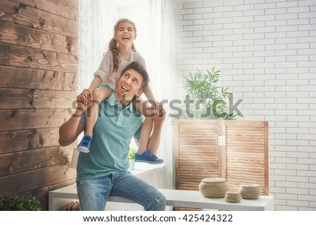 Happy loving family. Father and his daughter child girl playing together. Father's day concept. - stock photo
