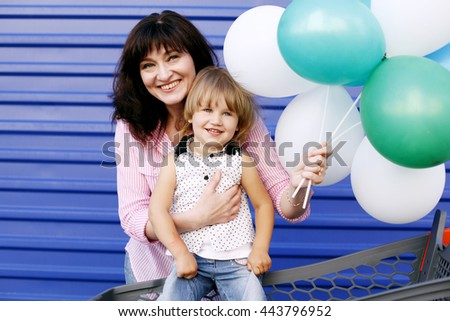Happy loving family. Grandmother And Granddaughter playing and hugging in a Store - stock photo