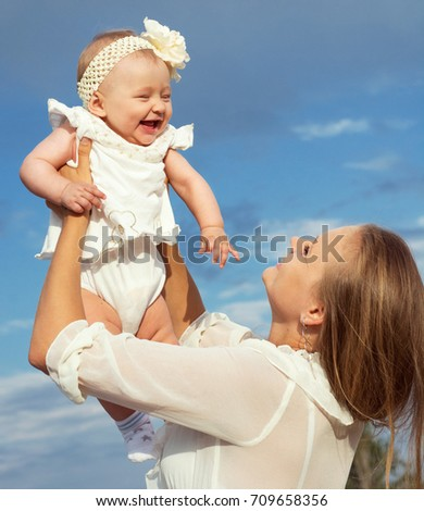 Happy loving family. Mother  and her child playing outdoor. park walk