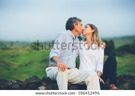 Happy loving middle aged couple kissing